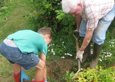 colin digging with grandson